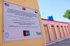 u s department of > photos > photo essays > essay view afghan officials placed a sign on the outer wall of the new orphanage in parwan
