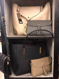 fully stocked purses and wallets and real deals on home decor