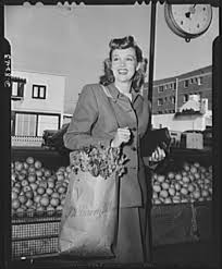 "I'll carry mine."" Betty Jane Rhodes, popular Paramount Pictures star, shops  and carries her own parcels, patriotically cooperating with the ""I'll Carry  Mine"" Campaign, sponsored by the Office of Defense Transportaion to"