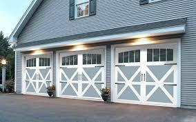 swing up garage door garage doors in the style of old carriage house doors they look