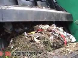 Image result for garbage truck compressor