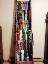 Found an old ladder at an antique sale and used it to hang scarves!  Fantastic