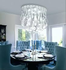 crystal chandeliers for dining room modern artistic dining room crystal chandelier over black round pedestal dining crystal chandeliers for dining room