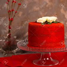 Beautiful Red Velvet Birthday Cake Decorated With White Roses