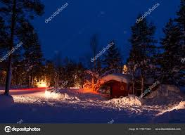 Camping Christmas Lights Car Lights In A Winter Forest Camping Stock Photo