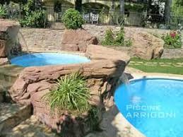 Cascate Da Giardino In Pietra Prezzi : Piscine interrate realizzate piscina fontanile sfioro a cascata