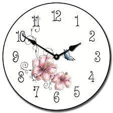 the pink fl decorative wall clock is round with a white background soft pink flowers