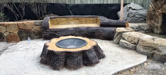 2. Rustic Stump Fire Pit