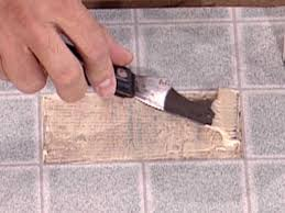 apply even coat of vinyl floor adhesive to floor