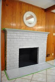 painted the brick fireplace surround wood mantel and tiled hearth with two coats of olympic premium no voc semi gloss paint in off the shelf white some