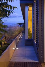 contemporary landscape lighting. led yard flood lights with modern landscape and concrete pavers corrugated siding mass planting night outdoor contemporary lighting