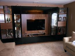 black glass entertainment center victor wall unit in black glass with mounted black entertainment center with glass doors