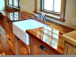 make solid cherry face grain with an integrated sloping drainboard on each side of a farm