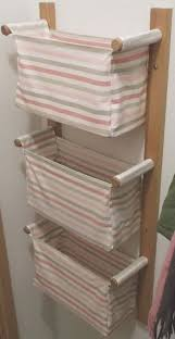 wall hanging storage with 3 ikea baskets