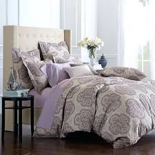 oversized duvet cover idea with classic pattern round black wood bedside table with undershelf extra large