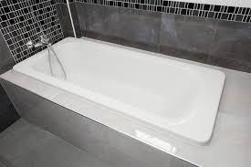 bathtub white ceramic interior in bathroom
