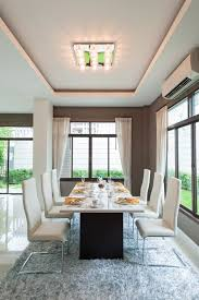 very simple white and dark grey dining room design table leg is dark grey and the