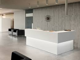 white backlit ikea reception desk with grey textured wall ideas for perfect modern office design