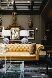 if i ever own a chesterfield sofa it will absolutely be upholstered in mustard yellow leather like this