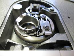 Singer Sewing Machine Repair Bobbin Case