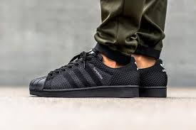adidas shoes superstar black. the all-black variation is a sleek take on classic silhouette. adidas shoes superstar black