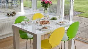 4 10 seater white gloss dining table and colourful dining chairs coloured