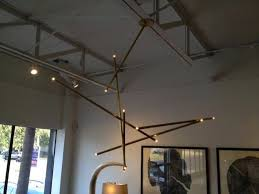 billy cotton pick up stick light sculpture black finish and also gorgeous billy cotton chandelier