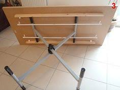 Coffee Table By Day. Simple Hack Using Ironing Board Mechanism Makes For A  Dining Table. Adjustable Height ...