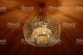soft light and shadows of a whimsical shape come from beautiful ceiling lamp royalty lights c19