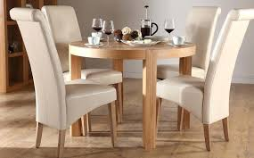 oak dining table 4 chairs round oxford solid oak 120cm dining table with 4 cream chairs