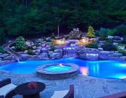 swimming pool lighting ideas. Swimming Pool With Rock Decor, Waterfall, And Lighting Effects Ideas A