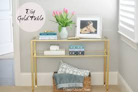 i had a small black console table from from my old office that i spray painted gold the shiny metallic took it from boring to bling in an