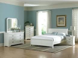 A Blue Beige Grey And White Bedroom With Sloped Ceiling Wardrobe ...