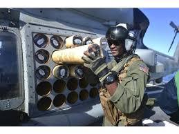 Naval Aircrewman Loads A Sonar Buoy Into An Mh 60r Sea