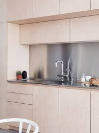 Stainless Steel Backsplash Kitchen Light Wood Cabinets With Stainless Steel Countertops And