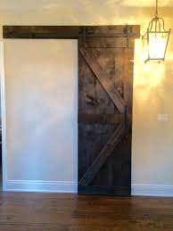 dark stained pine arrow pattern barndoor