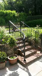ornate handrails and steps to garden