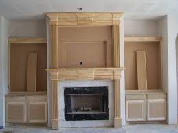 ravishing unfinished wooden fireplace mantel with white concrete surround