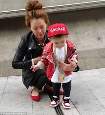 straight out of a a style conscious mother posed with her adorable