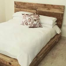 SIMPLE BED FRAME WITH STORAGE SPACE MADE OUT OF PALLET WOOD