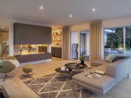 Wohnzimmer Mit Kamin Als Raumteiler Bungalow Haus Innen Modern