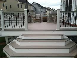 an azek deck with trex railings with baroque baers lighting is low voltage led lighting
