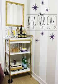redux gold bar carts ikea with liqours and straws and cocktail glasses and  books plus gold