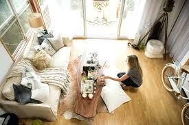 small cowhide rug splashy cable knit blanket in living room beach style with small living areas