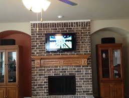 mount tv above brick fireplace at mounting