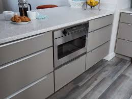 top entry microwave drawer in gray slab door cabinets