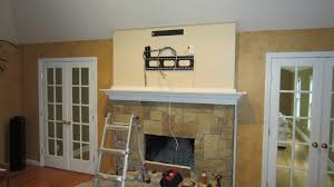 awesome home theatre plans with mounting tv above fireplace