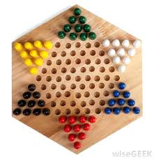 Game With Wooden Board And Marbles How To Play Chinese Checkers Checkers Are Played With Marbles And 27