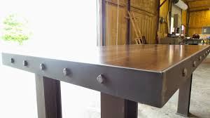 here at iron age office we design and build industrial furniture for commercial and residential spaces build industrial furniture