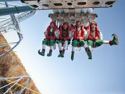 people dressed as elves ride alpengeist at busch gardens williamsburg getty images